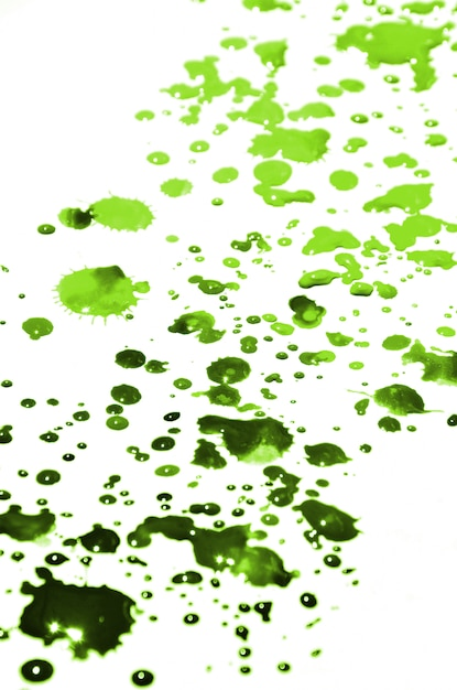 Light green paint drops on white paper Premium Photo