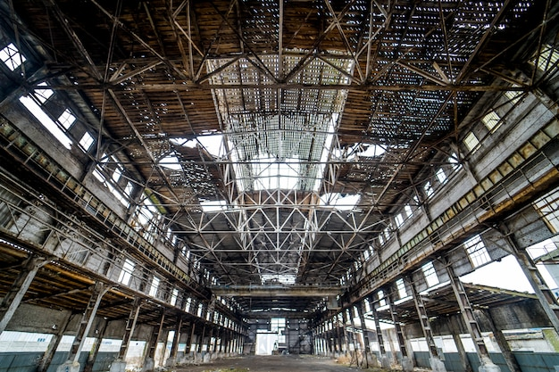 Light industrial interior of an old building with damaged ceiling and walls. Premium Photo