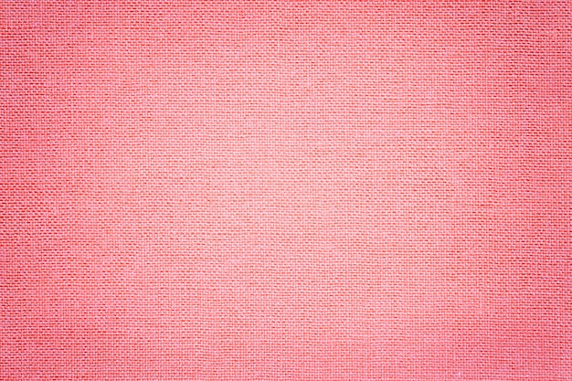Light pink background from a textile material with wicker pattern, Premium Photo