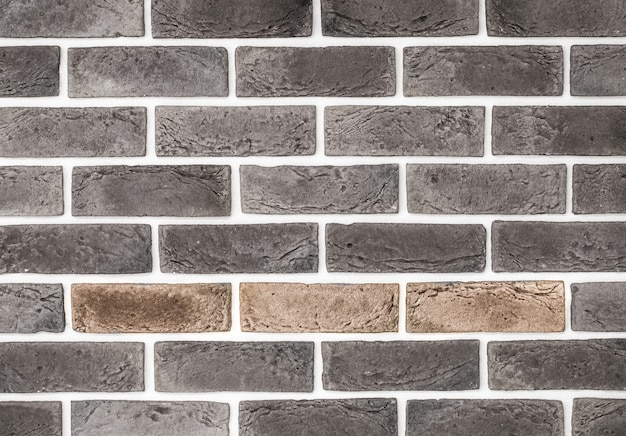 Light red brick wall, creative back-phonon, closeup Free Photo