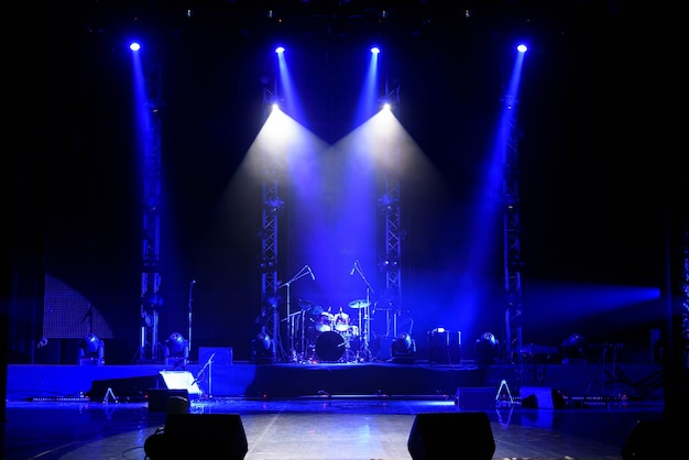 The light of searchlights in smoke on stage. Premium Photo