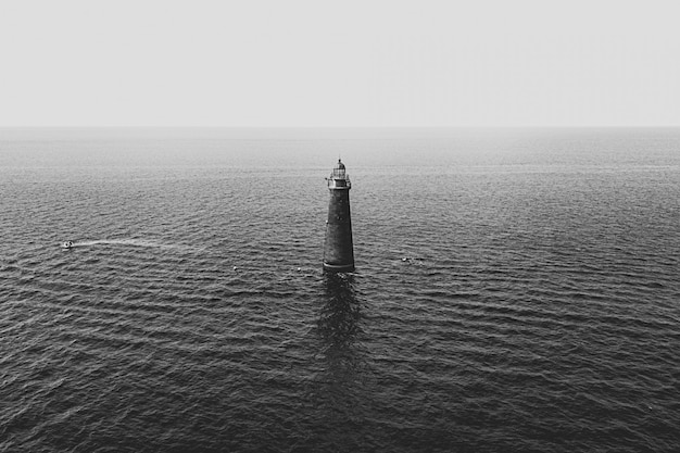 A light tower in the middle of the sea Free Photo