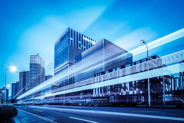 The light trails on the modern building Premium Photo
