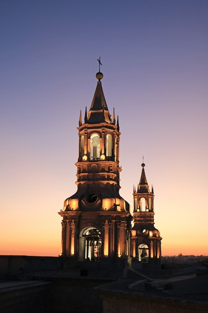 Light-up gorgeous bell tower of basilica cathedral of arequipa against twilight sky, arequipa, peru Premium Photo