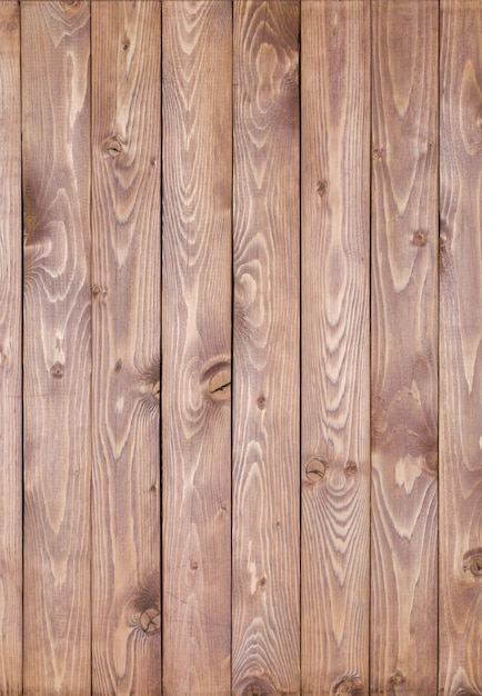 Light wooden background made of a narrow board, painted in brown, light beige. Premium Photo