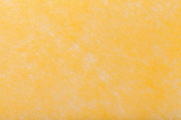 Light yellow background of felt fabric Premium Photo