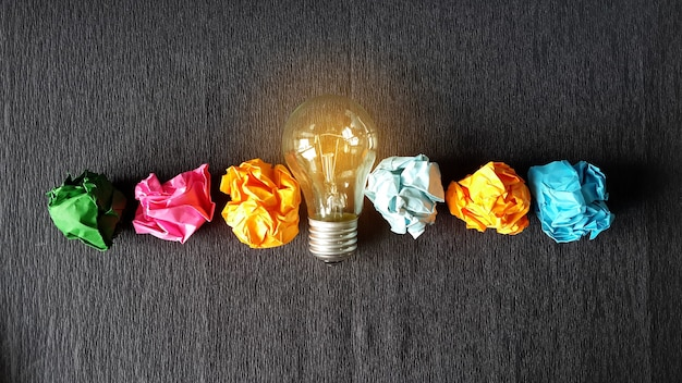 Lightbulb and crumpled papers Premium Photo