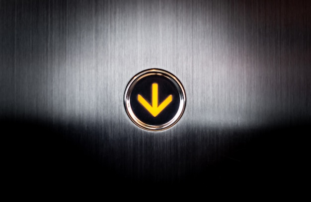 Lighten up going down button for lift elevetor Premium Photo