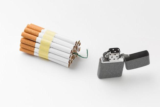 Lighter and cigarettes with fitil Free Photo