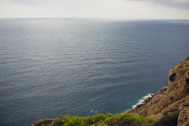 Lighthouse and viewpoint cap de formentor. tourist attraction. mallorca island coast in the evening. mountain. balears islands. landscape in the winter. great scenery. nice view. Premium Photo