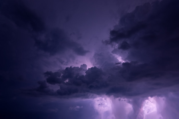 Lightning and rain clouds at night Premium Photo