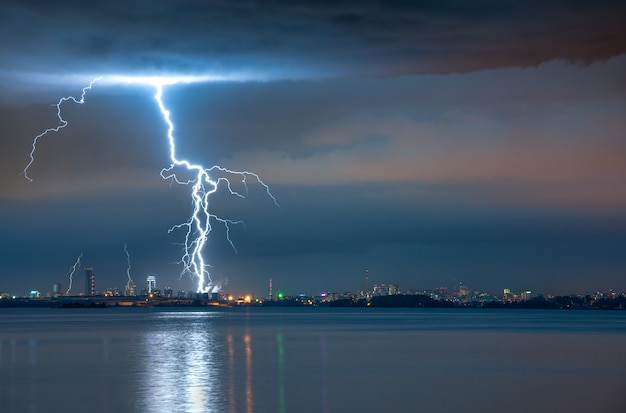 Lightning strike in a storm over the city Premium Photo