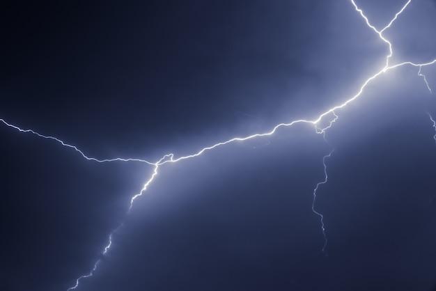Lightnings and thunder bold stike at summer storm Premium Photo