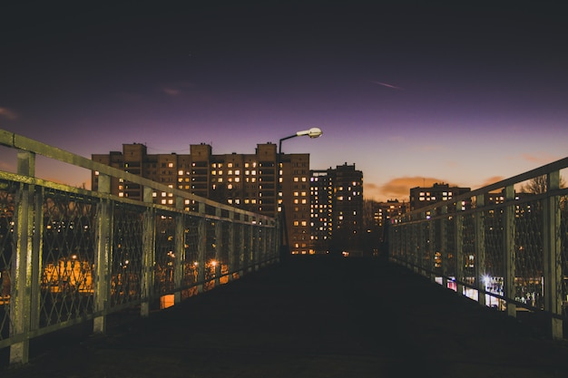 The lights of the night city. high houses at night. Premium Photo