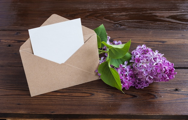 Lilac flowers on wooden table. Free Photo