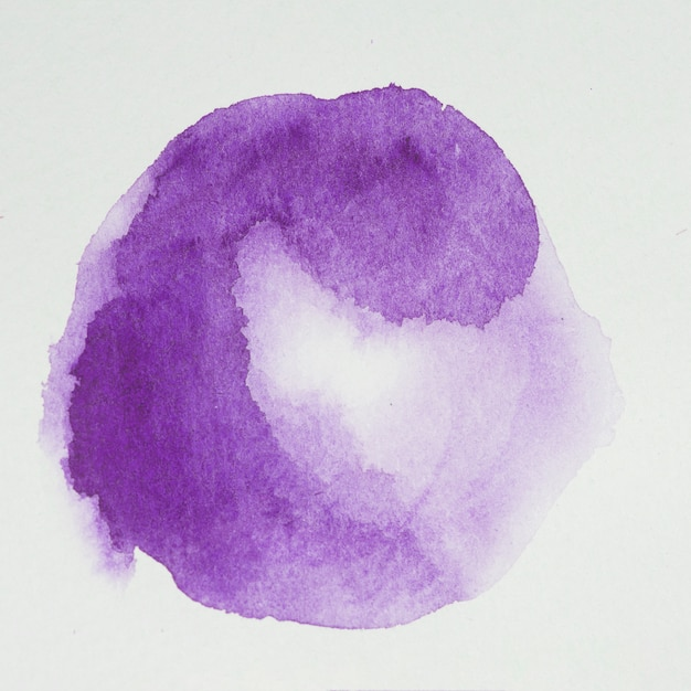 Lilac paints in form of circle on white paper Free Photo