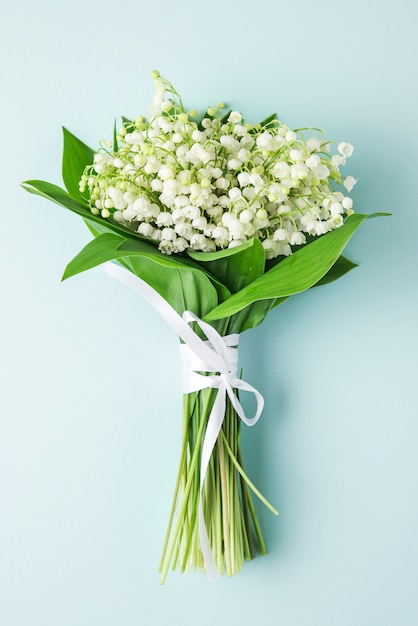 Premium Photo Lily Of The Valley Flowers Bouquet On Pastel Blue Flat Lay Wedding Vertical Orientation