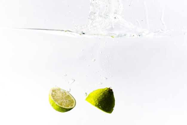 Lime drowning in water Free Photo