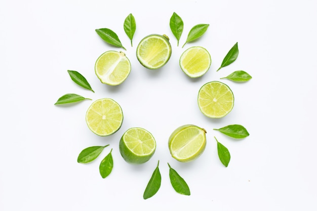 Limes with leaves isolated on white. Premium Photo