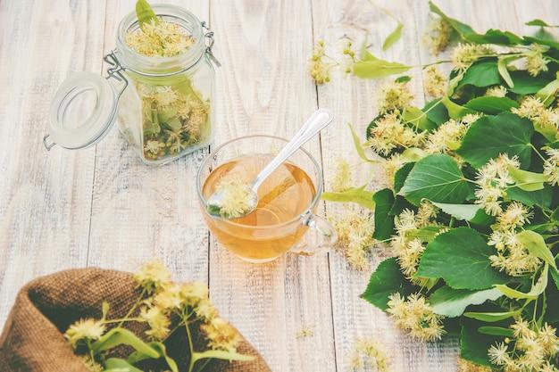 Linden tea and flowers. selective focus. drink. Premium Photo