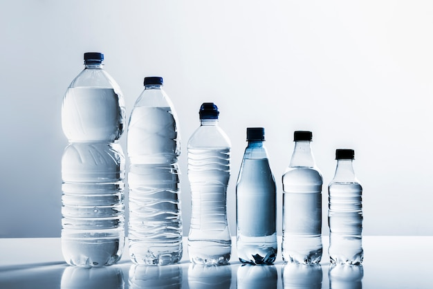 Line of bottles of water Free Photo
