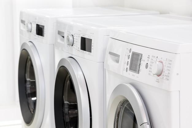 Line of laundry machines Premium Photo