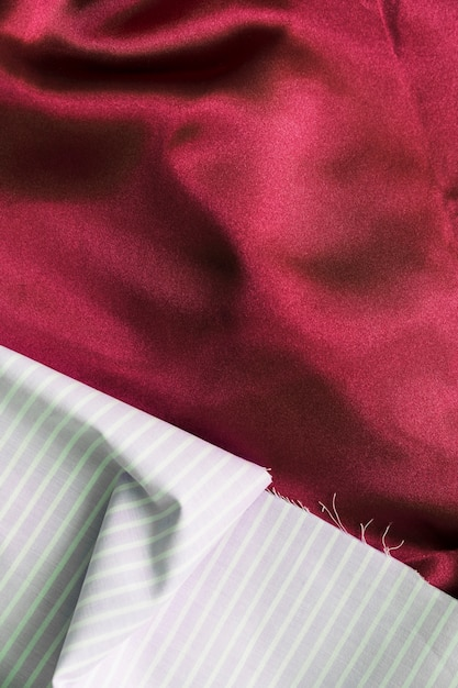 Line pattern fabric material on plain magenta textile Free Photo