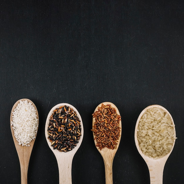 Line of spoons with rice Free Photo