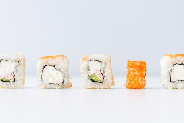 Lined up sushi rolls Free Photo