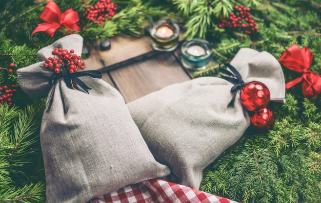 Linen bags with pine branches christmas decoration gift photo