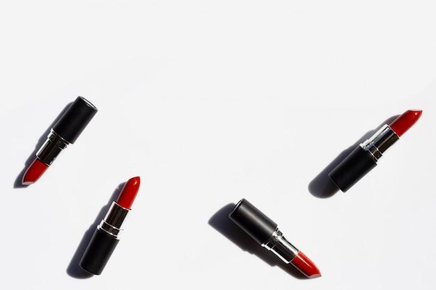 Lipsticks on white with shadow. Premium Photo