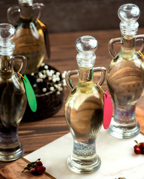 A liquid in ornate bottles Free Photo