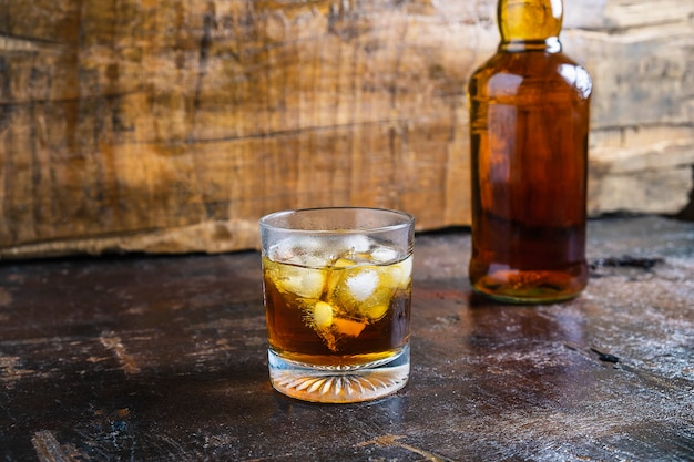 Liquor and liquor bottles on wooden table Premium Photo