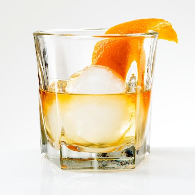 Liquour with an orange peel cocktail Free Photo