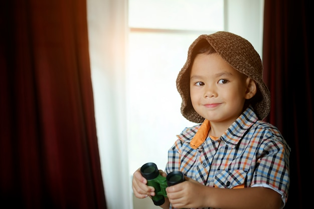 Little asian boy with toy sailing boat in hotel room. travel and adventure concept Premium Photo