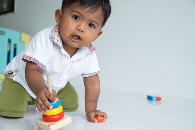 Little baby boy play wooden toy at room Premium Photo