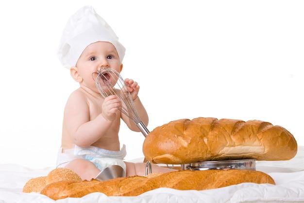 白で隔離の小さな赤ちゃんシェフ Premium写真