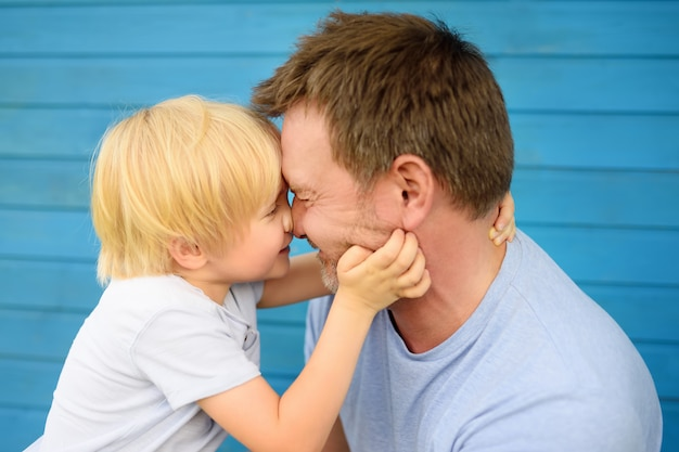 Little baby embrace his father. Premium Photo