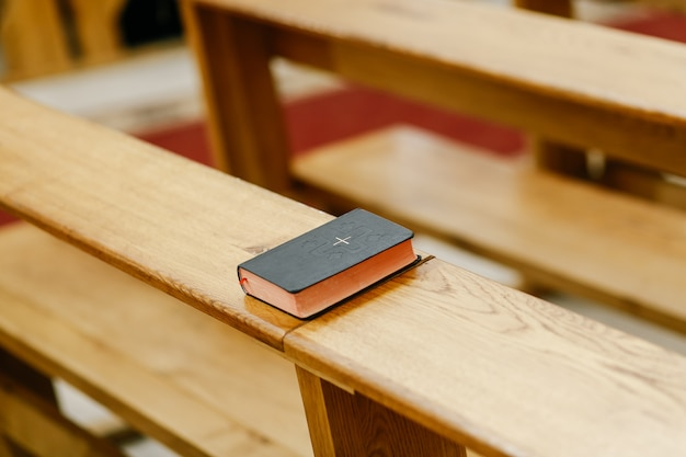 The little bible lies in the church Premium Photo