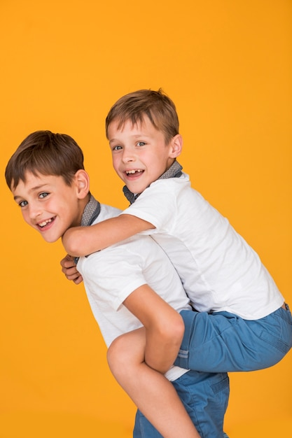 Little boy being carried on his brother back Free Photo