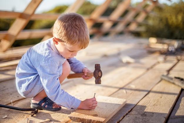 Little boy on the construction Premium Photo