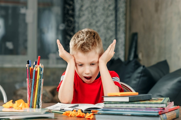 Little boy doing homework in school. Premium Photo