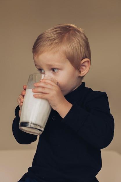 Free Photo | Little boy drinking milk