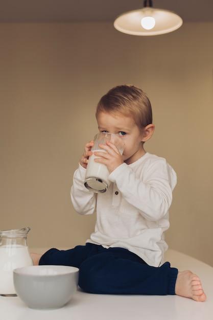 Little boy drinking milk Free Photo