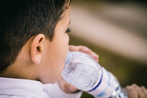 Little boy drinking water. close up and copy space Premium Photo