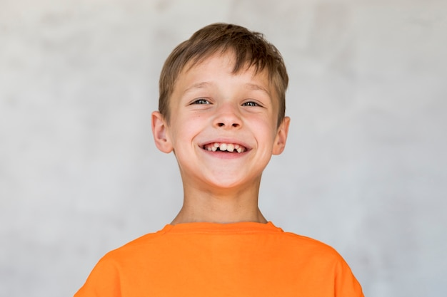 Little boy expressing happiness Free Photo