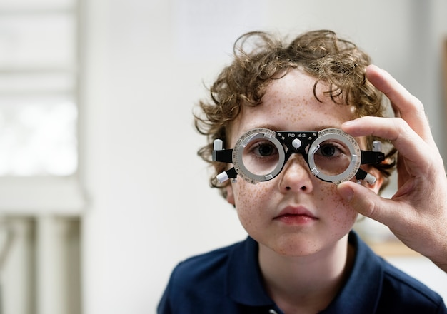 Little boy getting his eyes checked Premium Photo