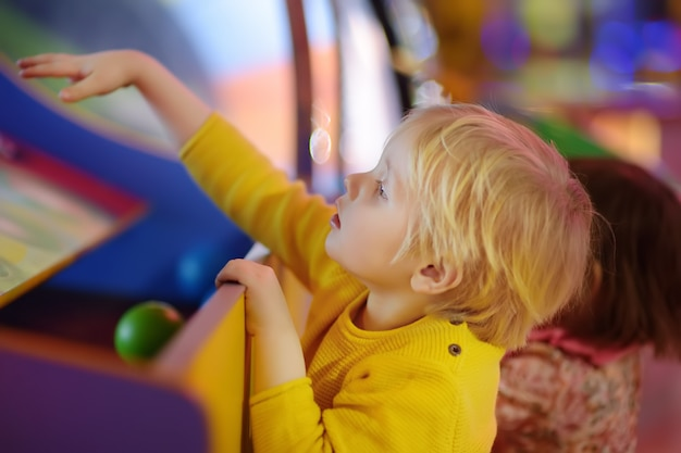 Little boy having fun in amusement in play center Premium Photo