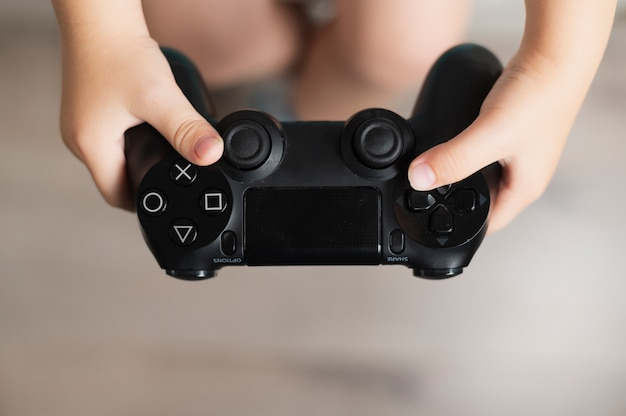 Little boy holding a controller close-up Free Photo