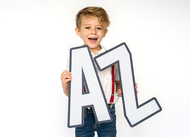 Little boy holding a-z Free Photo